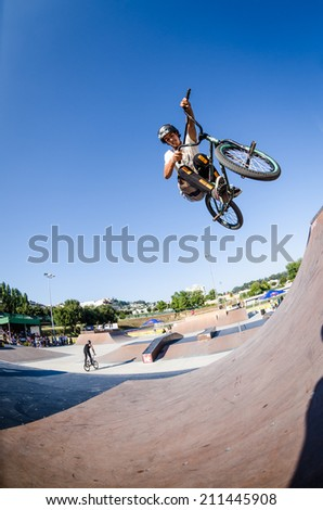 FELGUEIRAS, PORTUGAL - AUGUST 17, 2014: Helder Parente during the 1st Stage of the DVS BMX Series 2014 by Fuel TV. - stock photo