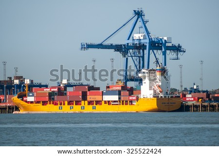 FELIXSTOWE, ENGLAND - JUNE 8, 2006: Container ship at container terminal in the port of Felixstowe, Suffolk, England, UK