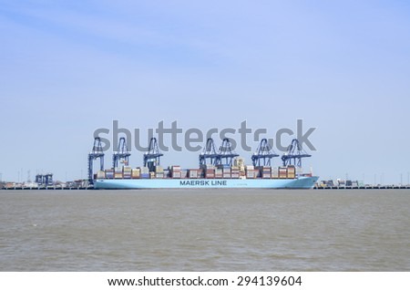 Felixstowe port, Suffolk, England. UK. 2 May 2015-Maersk container ship being loaded at one of Britain,s  ports,