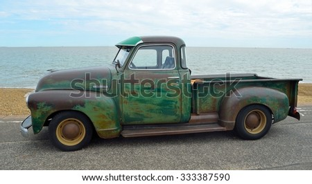 FELIXSTOWE, SUFFOLK, ENGLAND - AUGUST 29, 2015: Classic  Chevrolet 3100 pickup truck with some rust on Felixstowe seafront. - stock photo