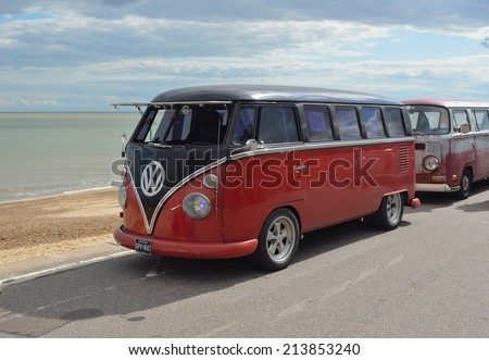 FELIXSTOWE, SUFFOLK, ENGLAND  AUGUST 23, 2014: Classic VW camper van in rally on Felixstowe seafront. - stock photo