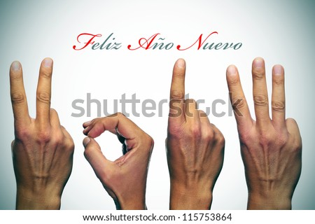 feliz ano nuevo, happy new year written in spanish, with hands forming number 2013 - stock photo