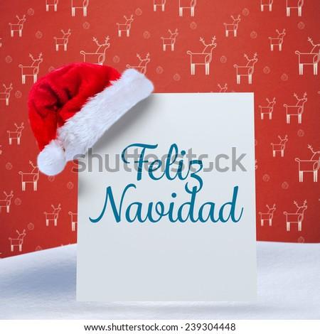 Feliz navidad against red reindeer pattern - stock photo
