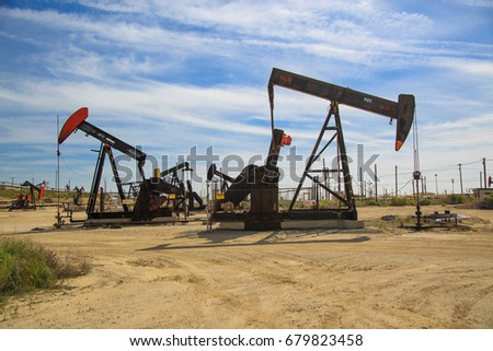 Fellows, CA - APRIL 5: Working oil pumps at large oil field on April 5 2017 in Fellows, CA