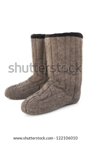 Fur boots Stock Photos, Illustrations, and Vector Art