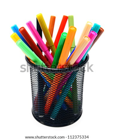 Felt-tip pens in a basket. - stock photo