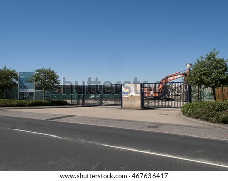 Feltham, London, Central Way, Middlesex, England - August 12, 2016: Construction site entrance to demolition works with health and safety personal protection sign