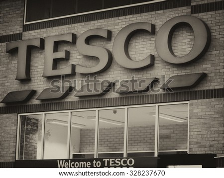 Feltham, London, Middlesex, England - August 04, 2015: Tesco supermarket sign over main entrance to store, company founded by Jack Cohen in 1919 - stock photo