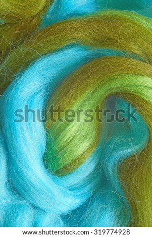 Felting wool. Colourful fibers of wool for wallow.  - stock photo