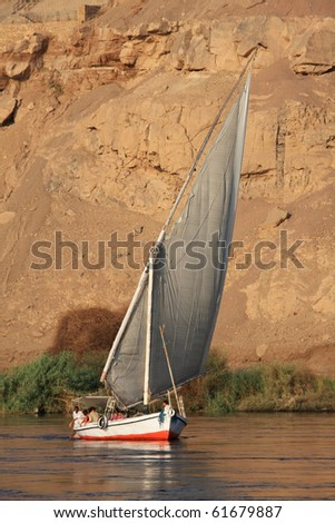 Felucca boat sailing in Nile River, Egypt - stock photo
