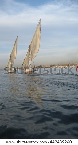 Feluccas on the Nile River in Aswan, Egypt at dusk