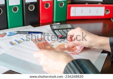 Female accountant counts money - stock photo