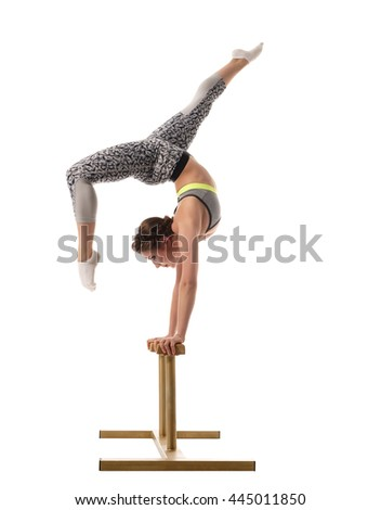 Female acrobat exercising on circus stands