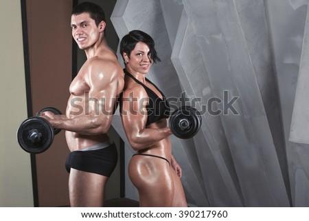 Female and male bodybuilder. - stock photo