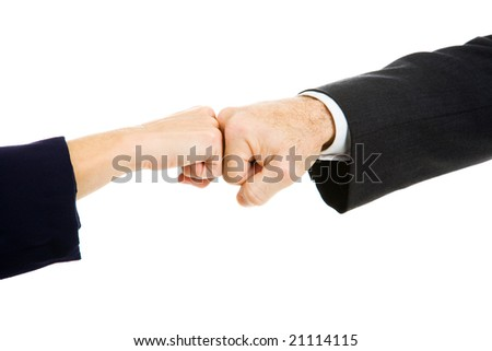 Female and male business people giving a fist bump.  Isolated on white.