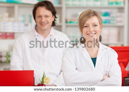 female and male co workers in a pharmacy