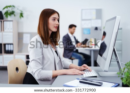 female and male colleague at work at the office - stock photo