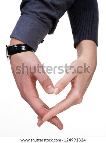 Female and male hands making love heart over white background - stock photo