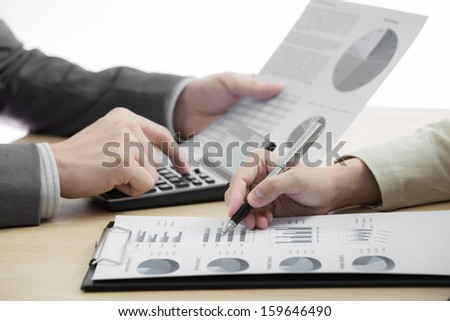 female and male hands pointing at business on table
