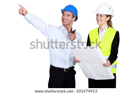 female architect all smiles accompanied by foreman