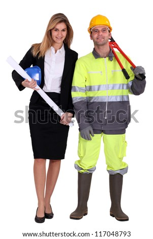 female architect and carpenter against studio background