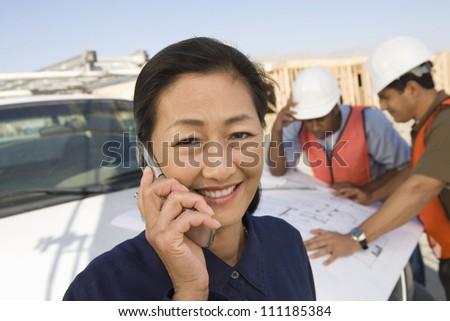 Female architect phoning - stock photo