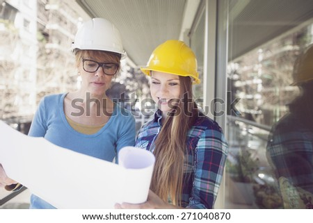 Female architects working with plan - stock photo