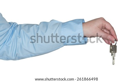 Female arm holding keys in his hand - stock photo