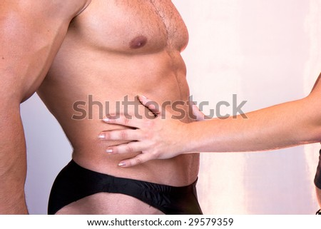 Female arms gentle touching male waist, two lovers - stock photo