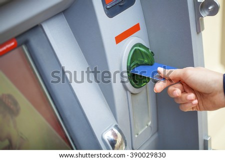 Female arms Take cash from the ATM, close up - stock photo
