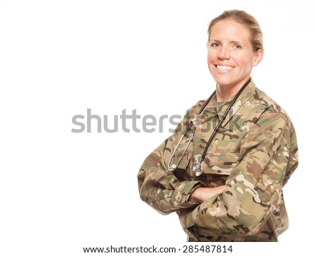 Female Army doctor or nurse in uniform on white background.  Female US Soldier in the medical field with arms crossed and copy space. - stock photo