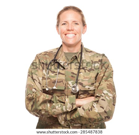 Female Army doctor or nurse in uniform on white background.  Female US Soldier in the medical field with arms crossed smiling. - stock photo