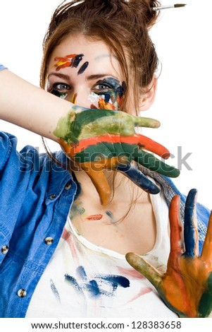 Female artist with paint smeared face and hands isolated on white background - stock photo