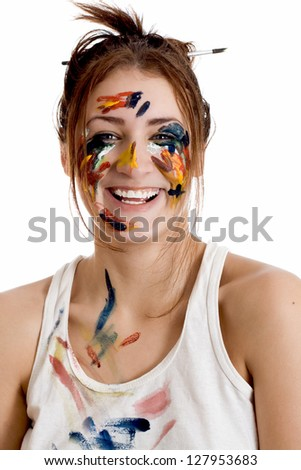Female artist with paint smeared face isolated on white background