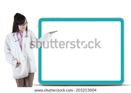 Female asian doctor presenting copyspace. isolated on white background - stock photo