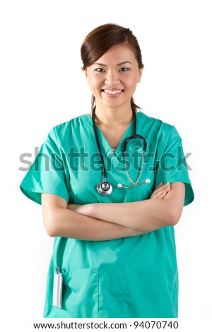 Female Asian doctor wearing a green scrubs and stethoscope. Isolated on white. - stock photo