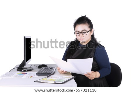 Female Asian entrepreneur working on desk while reading paperwork, isolated on white background