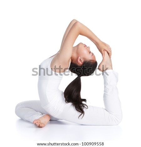 female asian teenager doing yoga against white background - stock photo