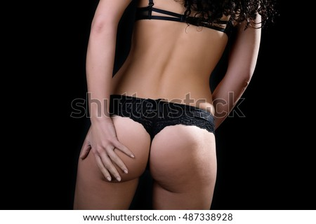 female ass and hands on a black background