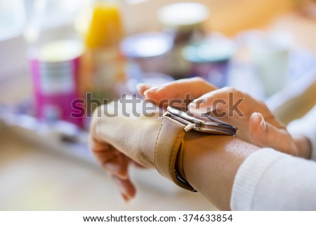 Female at home texting a Message on smart-watch - stock photo