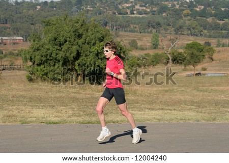 Female athlete in red training.