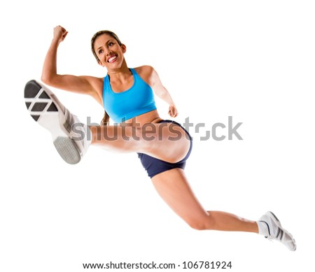 Female athlete jumping - isolated over a white background - stock photo