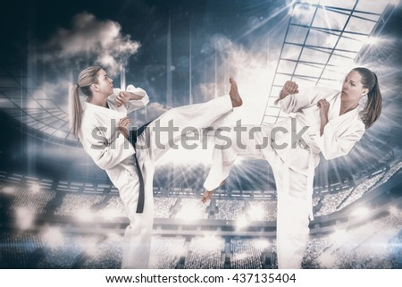 Female athlete practicing judo against overhead view of playing field - stock photo