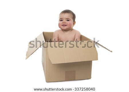 Female baby playing with carton