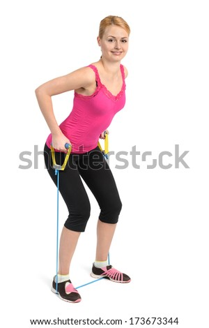 Female back and arms exercise using rubber resistance band - stock photo
