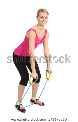 Female back extension exercise  using rubber resistance band - stock photo