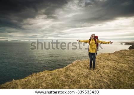 Female backpacker tourist in Icleand ready for adventure  - stock photo