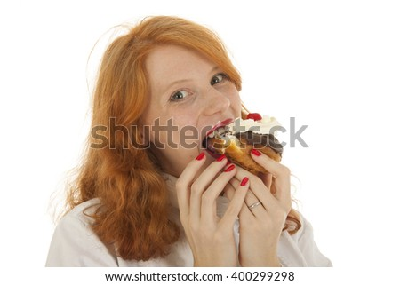 Female baker chef with red hair eating pastry isolated over white background - stock photo