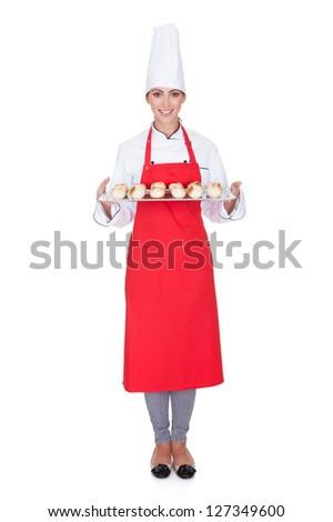 Female Baker Holding Fresh Bread. Isolated On White - stock photo