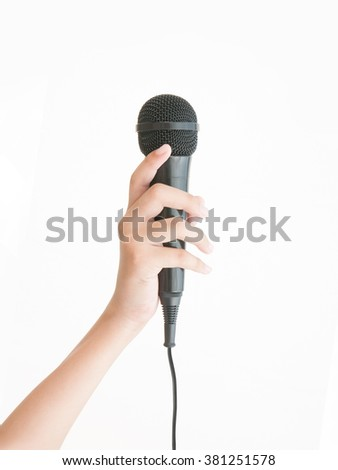 Female beauty hand holding microphone on white background